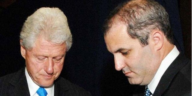 Band, (r.), is a longtime aide to the former president.