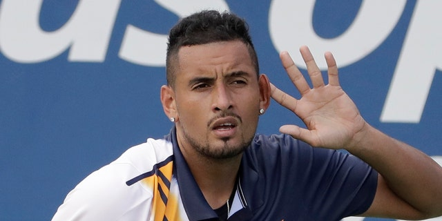 Nick Kyrgios, of Australia, reacts against Pierre-Hugues Herbert, of France, during the second round of the U.S. Open tennis tournament.
