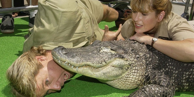 Steve and Terri Irwin pose with a crocodile in 2002.