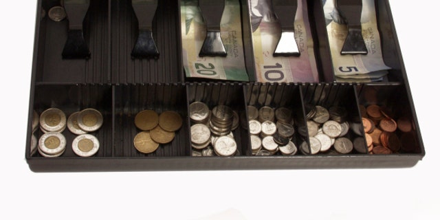 store's cash register in canadian funds