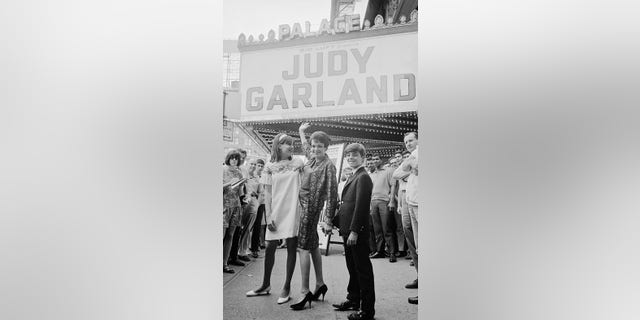 27 Jul 1967 --- Original caption: To the Palace. The famed singer Judy Garland stands with her children Lorna, 14, and Joey Luft, 12, outside The Palace Theatre in New York where she played two memorable earlier stands in 1951 and 1956. She's back for a return four-week engagement titled, At Home at The Palace, to be presented by her former husband Sid Luft. --- Image by © Bettmann/CORBIS