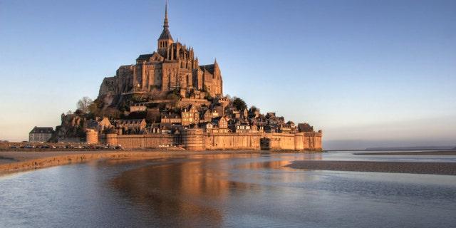 Mont Saint Michel bay taken at dawn. Normandy , France .