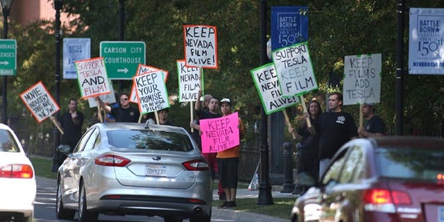 Sept. 10, 2014: Protesters march in front of the Capitol in Carson City, Nev. (AP)