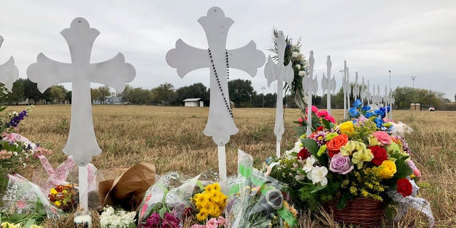 Crosses mark the number of victims in the shooting at a church in Sutherland Springs, Texas.
