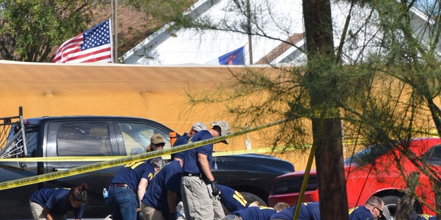 Federal officials investigate the scene of a church shooting in Sutherland Springs, Texas.