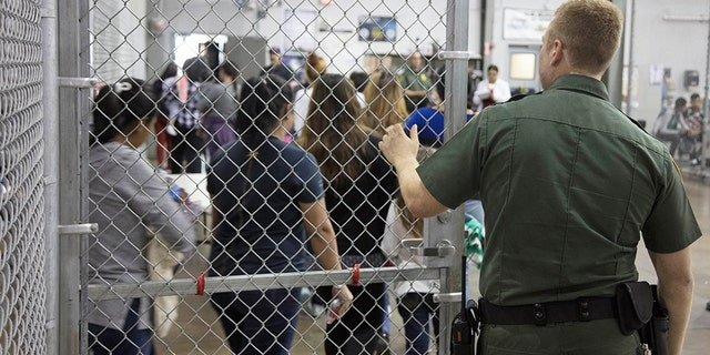 A view of inside U.S. Customs and Border Protection (CBP) detention facility shows detainees inside fenced areas at Rio Grande Valley Centralized Processing Center in Rio Grande City, Texas, U.S., June 17, 2018. Picture taken on June 17, 2018.   Courtesy CBP/Handout via REUTERS   ATTENTION EDITORS - THIS IMAGE HAS BEEN SUPPLIED BY A THIRD PARTY. - RC1E987A5800