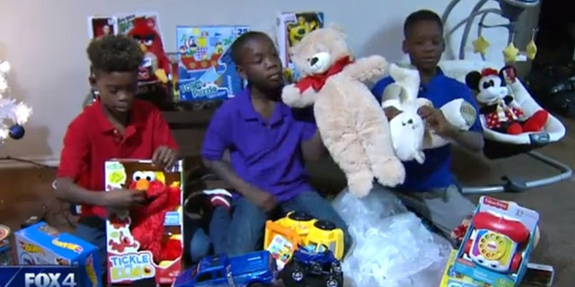 Brittney Curry's three sons were given new Christmas gifts from Fort Worth Police Officers after theirs were stolen from her truck.