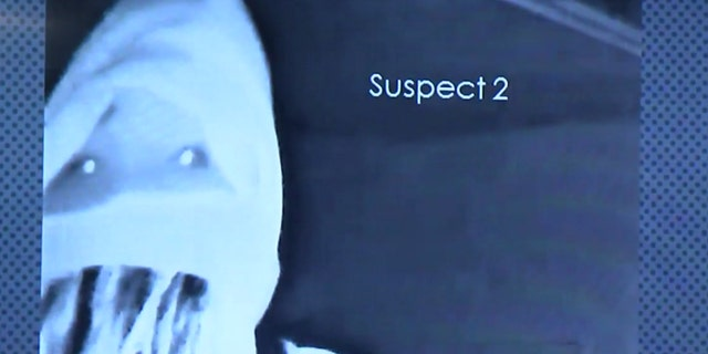 A second suspect in the violent home invasion can be seen on a surveillance camera.