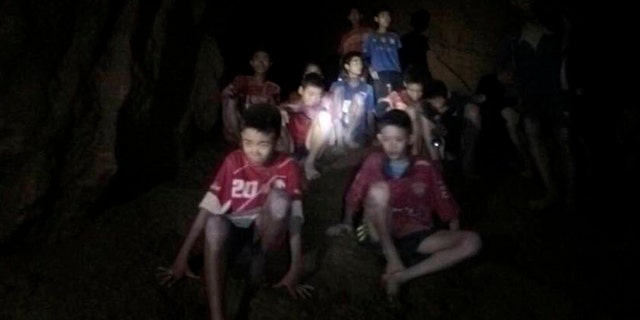 This Monday, July 2, 2018, file photo released by Tham Luang Rescue Operation Center, shows the boys and their soccer coach as they were found in a partially flooded cave, in Mae Sai, Chiang Rai, Thailand.