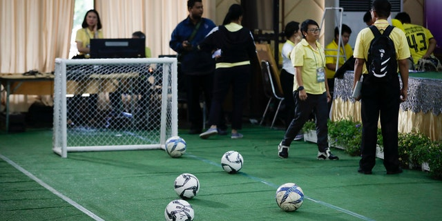A mini soccer field being set up before a press conference on the 12 boys and coach released from the hospital in Chiang Rai province, northern Thailand, Wednesday, July 18, 2018