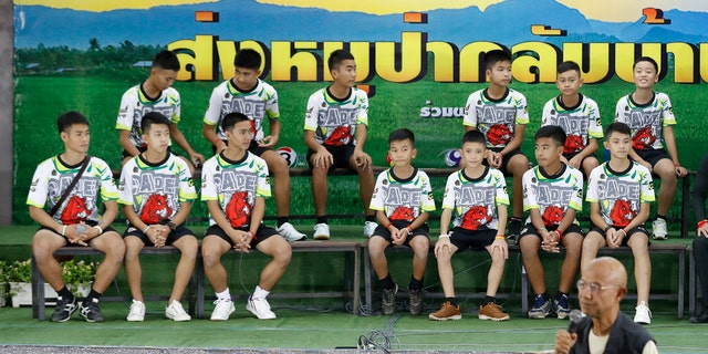 Members of the rescued soccer team and their coach sit during a press conference discussing their ordeal in the cave in Chiang Rai, northern Thailand, Wednesday, July 18, 2018