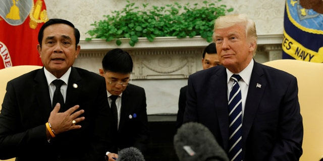 U.S. President Donald Trump meets with Thai Prime Minister Prayut Chan-o-Cha in the Oval Office of the White House in Washington, U.S., October 2, 2017. REUTERS/Kevin Lamarque - RC1E138B1B30