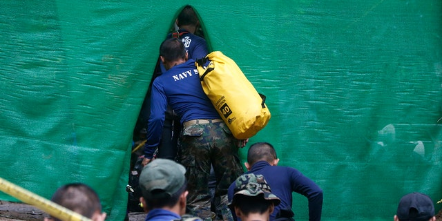 Rescuers arrive near a cave where 12 boys and their soccer coach have been trapped since June 23, in Mae Sai, Chiang Rai province, in northern Thailand, July 8, 2018.