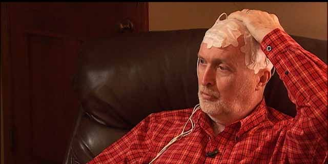 Stan Thain, 58, is using the Optune system as part of his treatment for brain cancer.