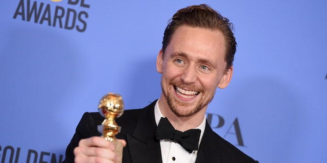 """Tom Hiddleston poses in the press room with the award for best performance by an actor in a limited series or a motion picture made for television for """"The Night Manager"""" at the 74th annual Golden Globe Awards at the Beverly Hilton Hotel on Sunday, Jan. 8, 2017, in Beverly Hills, Calif. (Photo by Jordan Strauss/Invision/AP)"""