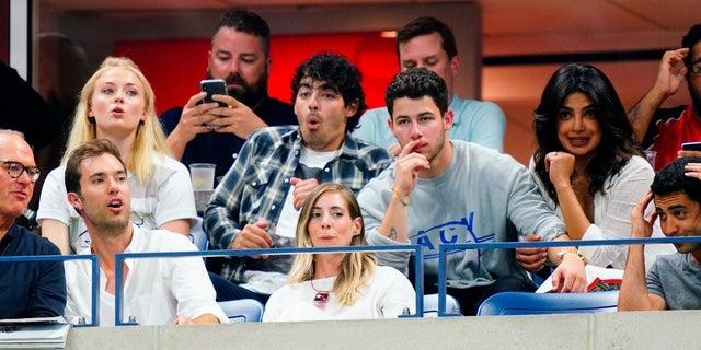 Sophie Turner, Joe Jonas, Nick Jonas and Priyanka Chopra sit together and watch the U.S. Open on Tuesday, September 4, 2018.