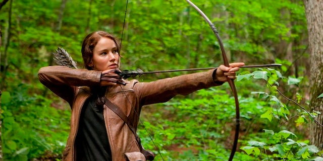 "FILE - In this image released by Lionsgate, Jennifer Lawrence portrays Katniss Everdeen in a scene from ""The Hunger Games,"" opening on Friday, March 23, 2012.  Lionsgate announced today that ""The Hunger Games: Mockingjay,"" Part 1 will be released on November 21, 2014, and Part 2, will be released on November 20, 2015. (AP Photo/Lionsgate, Murray Close, File)"