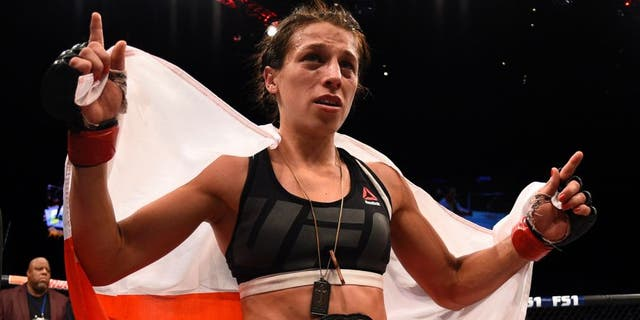 LAS VEGAS, NV - JULY 08: Joanna Jedrzejczyk of Poland celebrates after her decision victory over Claudia Gadelha of Brazil in their women's strawweight championship bout during The Ultimate Fighter Finale event at MGM Grand Garden Arena on July 8, 2016 in Las Vegas, Nevada. (Photo by Jeff Bottari/Zuffa LLC/Zuffa LLC via Getty Images)