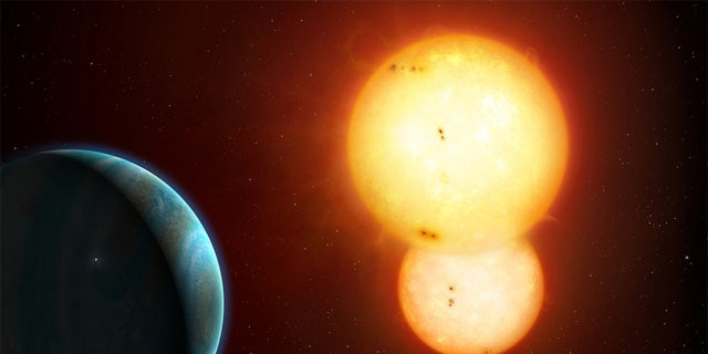An artist's illustration of Kepler-35 b, a Saturn-size planet around a pair of sun-size stars.