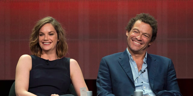 "Cast members Ruth Wilson and Dominic West smile at a panel for the Showtime television series ""The Affair"" during the Television Critics Association Cable Summer Press Tour in Beverly Hills, California July 18, 2014. REUTERS/Mario Anzuoni"