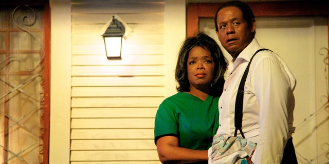 """This film image released by The Weinstein Company shows Oprah Winfrey as Gloria Gaines, left, and Forest Whitaker as Cecil Gaines in a scene from """"Lee Daniels' The Butler."""" (AP Photo/The Weinstein Company, Anne Marie Fox)"""
