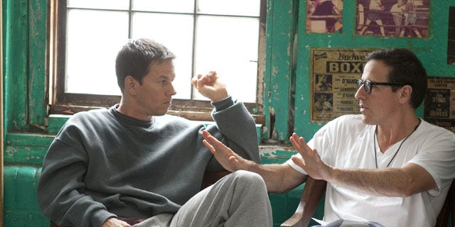 In this publicity image released by Paramount Pictures, Mark Wahlberg, left, and director David O. Russell are shown on the set of The Fighter. Micky Ward, the boxer who was the subject of the new movie, has pledged his brain and spinal cord to a Boston University.