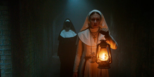 """This image released by Warner Bros. Pictures shows Taissa Farmiga in a scene from """"The Nun."""" (Warner Bros. Pictures via AP)"""