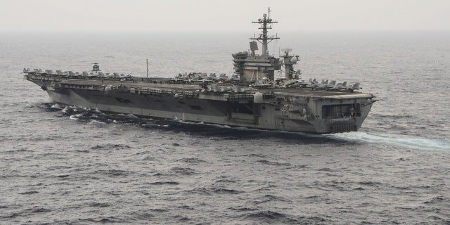 The aircraft carrier USS Theodore Roosevelt (CVN 71) transits the South China Sea in this U.S. Navy picture taken Oct. 29, 2015. (REUTERS/U.S. Navy/Mass Communications Specialist 3rd Class Anthony N. Hilkowski/Handout via Reuters)