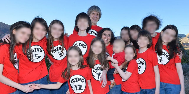 David and Louise Turpin are pictured with their 13 children in April 2016.