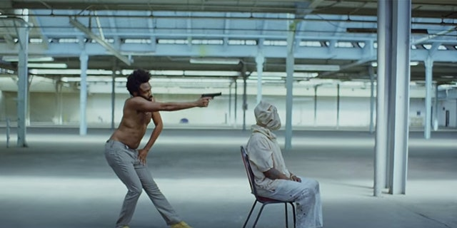 "Childish Gambino shoots a man in his music video for ""This Is America."""
