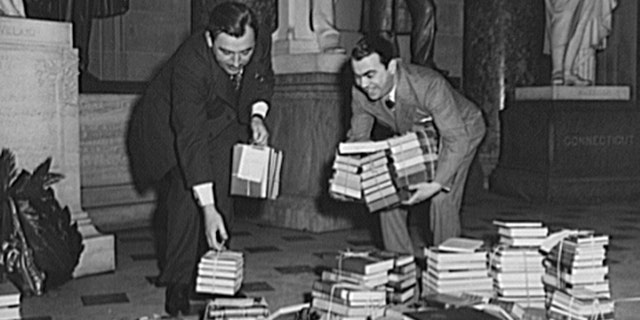 Two members of Congress who contributed books for the 1943 Victory Book Campaign: Representative Thomas D'Alesandro Jr. (left) of Maryland; and Representative Samuel Weiss of Pennsylvania