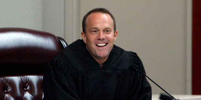 Utah Supreme Court Justice Thomas R. Lee takes his place at the bench after being confirmed by U.S. Supreme Court Justice Clarence Thomas at the Matheson Courthouse, in Salt Lake City. President Donald Trump's list of candidates for the Supreme Court, posted on White House website in November 2017 includes Lee.