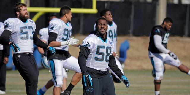 File photo - Carolina Panthers' Thomas Davis stretches during NFL football practice, Friday, Jan. 29, 2016, in Charlotte, N.C. (AP Photo/Chuck Burton)