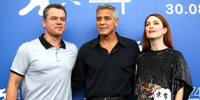 """Director George Clooney and actors Matt Damon and Julianne Moore pose during a photocall for the movie """"Suburbicon"""" at the 74th Venice Film Festival in Venice, Italy September 2, 2017. REUTERS/Alessandro Bianchi - RC1CF0310E90"""