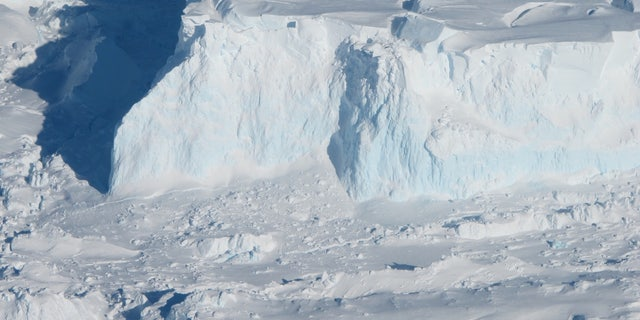 Thwaites Glacier acts like a hulk cork that binds behind a West Antarctic Ice Sheet.