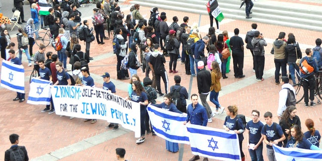 Pro-Israel students at UC Berkeley demonstrate in front of Students for Justice in Palestine.