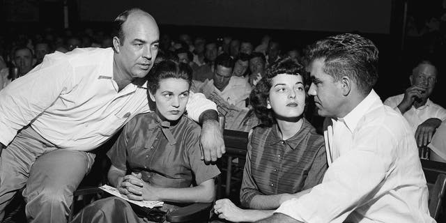 In this Sept. 23, 1955, file photo, J.W. Milam, left, his wife, second left, Roy Bryant, far right, and his wife, Carolyn Bryant, sit together in a courtroom in Sumner, Miss. Bryant and his half-brother Milam were charged with murder but acquitted in the kidnap-torture slaying of 14-year-old black teen Emmett Till in 1955 after he allegedly whistled at Carolyn Bryant.