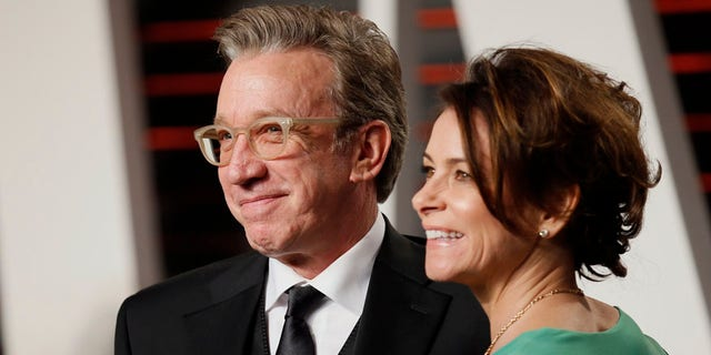 Actor Tim Allen and his wife Jane Hajduk arrive at the Vanity Fair Oscar Party in Beverly Hills, California February 28, 2016.  REUTERS/Danny Moloshok - RTS8IGS