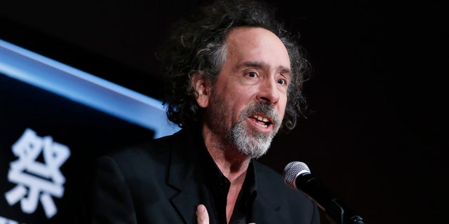 Director Tim Burton speaks as he receives the SAMURAI award during the closing ceremony of the Tokyo International Film Festival in Tokyo October 31, 2014. REUTERS/Yuya Shino (JAPAN - Tags: ENTERTAINMENT SOCIETY) - RTR4CATP