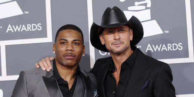 Nelly (pictured here with Tim McGraw) says he will countersue Greene.