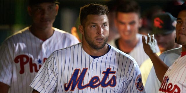 Scottsdale Scorpions left fielder Tim Tebow (15), of the New York Mets organization, in the dugout during a game against the Salt River Rafters on Oct. 12, 2016, at Scottsdale Stadium in Scottsdale, Arizona. Salt River defeated Scottsdale 6-4. (Mike Janes/Four Seam Images via AP)
