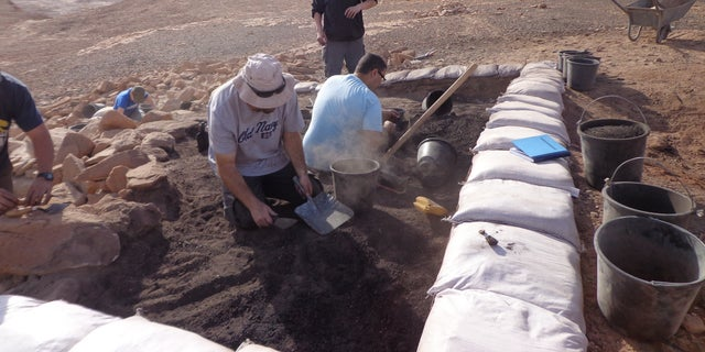 The excavation of a metallurigical workshop at Site 34.