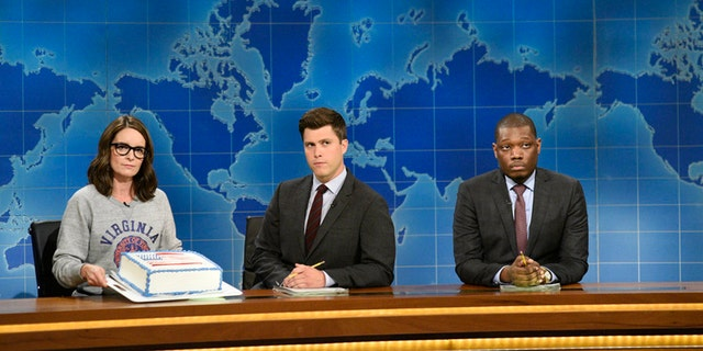 Pictured: (l-r) Tina Fey, Colin Jost and Michael Che at the Weekend Update desk on August 17, 2017.