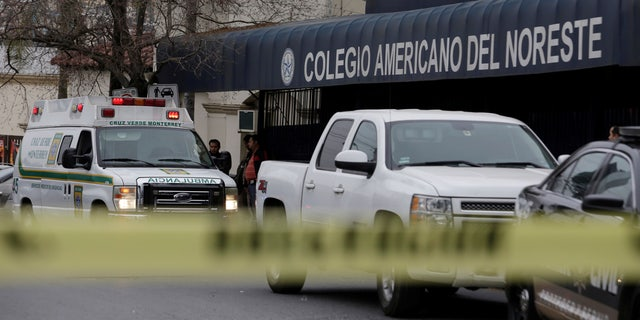 A yellow police line cordons off access to the Colegio Americano del Noreste after a student opened fire.