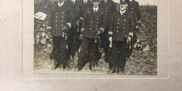 Picture of Charles Lightoller (center) (Henry Aldridge & Son).
