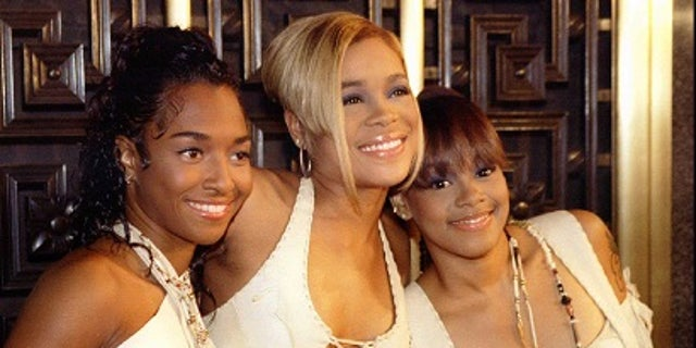 """TLC singer Tionne """"T-Boz"""" Watkins (middle) said her mentally ill cousin was shot 18 times by Illinois police officers."""