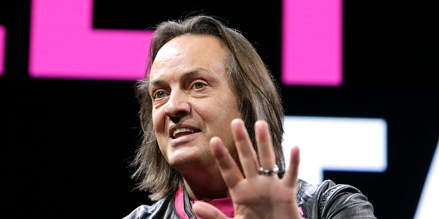 T-Mobile US President and CEO John Legere announced the addition of 2.1 million net customers in the fourth quarter and 8.2 million net customers for 2016 during the Un-carrier Next event at CES on Thursday, Jan. 5, 2017, in Las Vegas. (Bizuayehu Tesfaye/AP Images for T-Mobile)