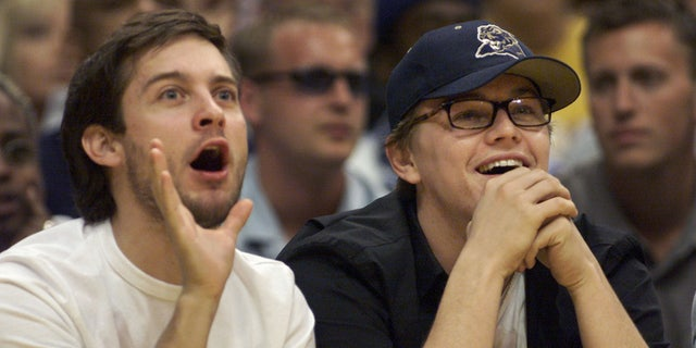 Actors Tobey Maguire (L) and Leonardo DiCaprio take in Game 1 of the NBA Western Conference finals between the Los Angeles Lakers and the Portland Trail Blazers May 20 in Los Angeles. The two actors sat courtside for the game and watched Los Angeles defeat Portland 109-94.MB/SV - RTRUPU7