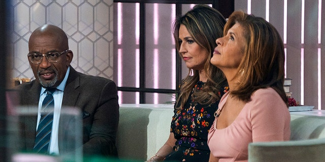 """Co-anchors Al Roker, from left, Savannah Guthrie and Hoda Kotb sit on the set of the of the """"Today"""" show Wednesday, Nov. 29, 2017, in New York, after NBC News fired host Matt Lauer. NBC News announced Wednesday, Nov. 29, 2017, that Lauer was fired for """"inappropriate sexual behavior.""""  (AP Photo/Craig Ruttle)"""