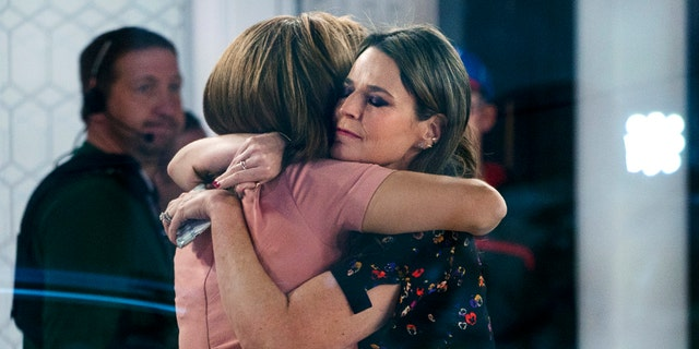 """Co-anchors Hoda Kotb, left, and Savannah Guthrie embrace on the set of the """"Today"""" show Wednesday, Nov. 29, 2017, in New York, after NBC News fired host Matt Lauer. NBC News announced Wednesday, Nov. 29, 2017, that Lauer was fired for """"inappropriate sexual behavior.""""  (AP Photo/Craig Ruttle)"""